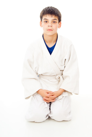 receptions: boy sitting waiting to fight isolated on white background