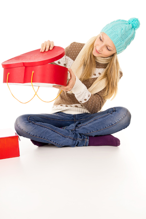 looking into: teen girl looking into gift Stock Photo