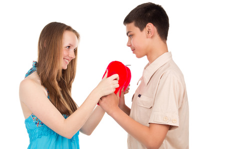 teen love: Young boy gives a girl a toy Stock Photo