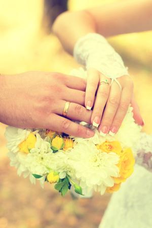 Bride and groom indicate rings