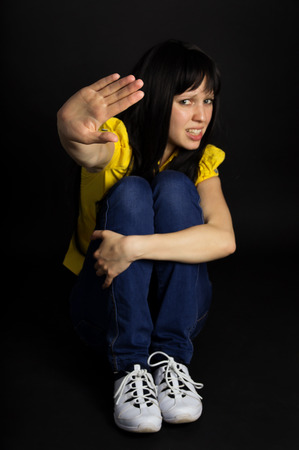 croud: Girl shows a hand stop