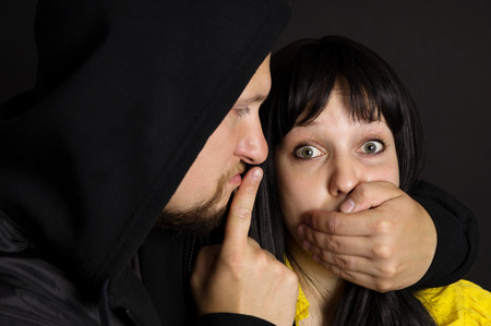 threatened: The attack on the girl, the man threatened the victim Stock Photo