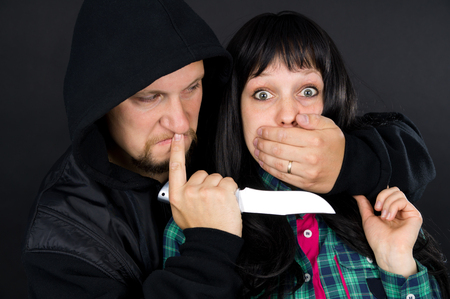 girl with knife: Robber, a man with a knife attacked girl Stock Photo