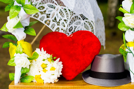dowry: Accessories, swings and heart bouquet with umbrella Stock Photo