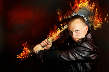 Art, angry guy with a burning guitar