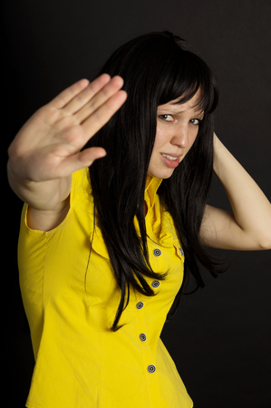 Violence, girl points at hand is not Stock Photo