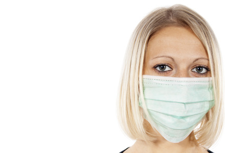 h1n1 vaccinations: portrait of a beautiful girl in a medical mask
