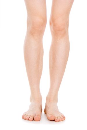 convulsions: male feet, isolated on white background Stock Photo