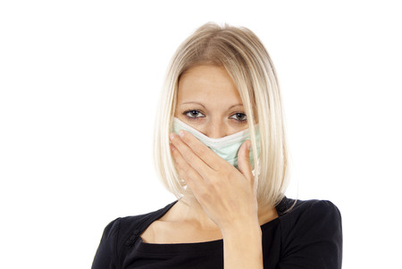 h1n1 vaccinations: sick girl in a medical mask isolated on a white background