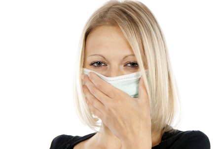 h1n1 vaccines: sick girl in a medical mask
