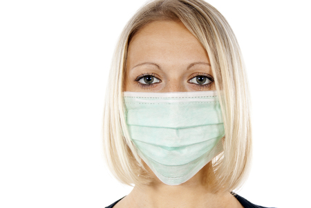 h1n1 vaccinations: portrait of a girl in a medical mask