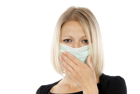 h1n1 vaccinations: girl who suffers a medical mask