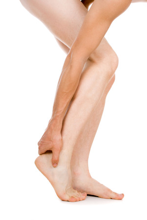 convulsions: male foot, heel, feet isolated on white background Stock Photo