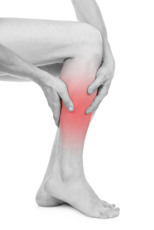 convulsions: Pain in the legs, guy, isolated on white background Stock Photo