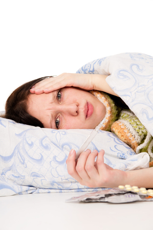 disease patients: the diseased girl lying in bed, aching head isolated on white background
