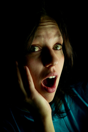 girl screams in fright in the dark Banco de Imagens