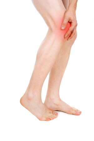 convulsions: the pain in the knee, boy, isolated on white background Stock Photo