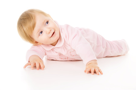 beautiful little baby learns to crawl isolated on white background Stock Photo
