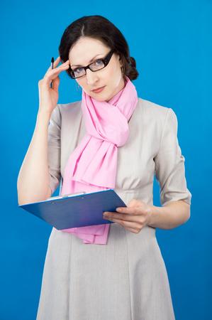 woman handle success: teacher girl on a blue background