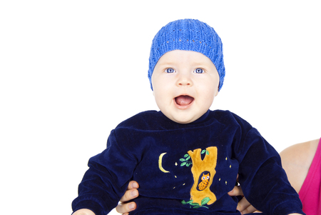 happy baby in a cap isolated on white background