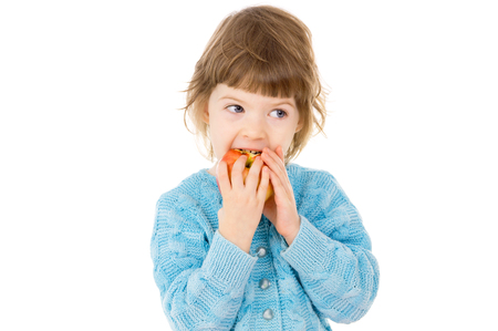 the little girl eats an Apple isolated on white background
