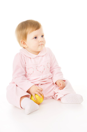 a little baby eat the Apple isolated on white background