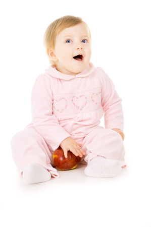 pretty little baby eat the Apple isolated on white background Stok Fotoğraf