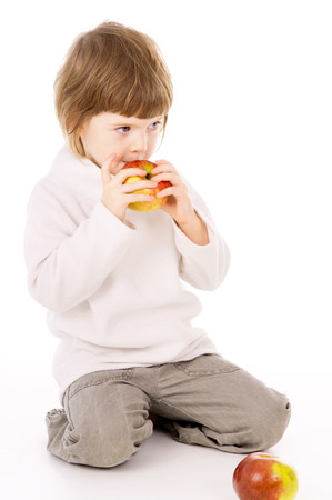 the little girl eat apples isolated on white background