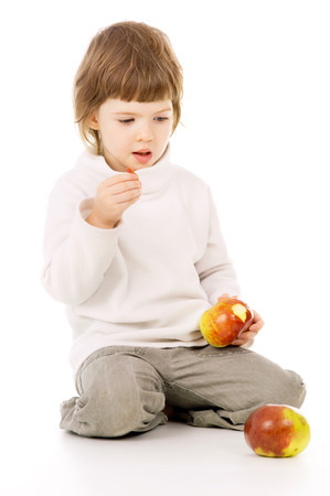 the little girl leads a healthy way of life, and eat apples isolated on white background