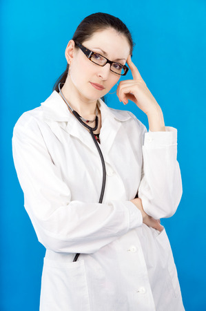 young doctor woman on a blue background