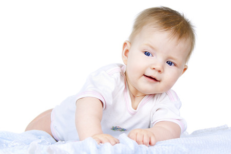 Happy blue baby lying on a white background