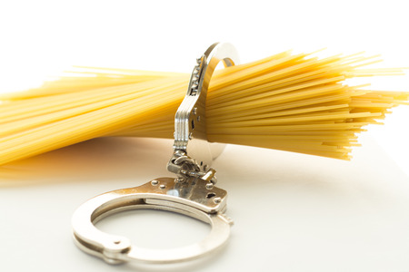Bunch of spaghetti tied together with a handcuffs