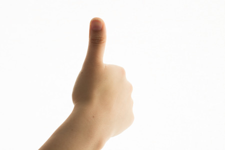 Woman hand isolated showing thumb up sign