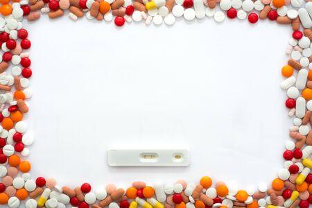 pregnancy test and drug capsules