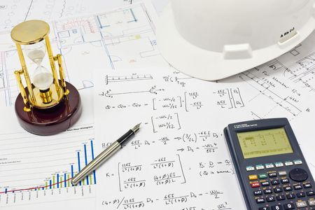 Desk of Civil Design Engineer who has just made structural analysis calculations using a scientific calculator. photo