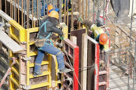 heights job: Workers are setting up forms for reinforced concrete walls