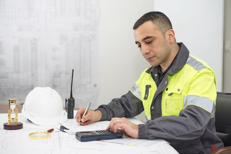 calculations: Civil engineer at construction office is making calculations