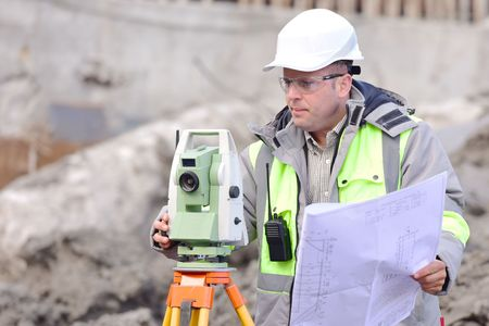 surveyor: Surveyor At Consruction Site