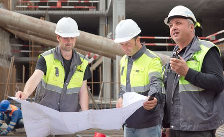 Civil Engineers at construction site are inspecting ongoing production according to design drawings. Stock Photo - 41906592