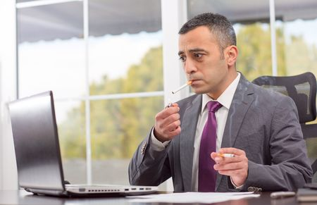 ambitious: Portrait Of Ambitious Young Businessman Who Is Smoking After Failure