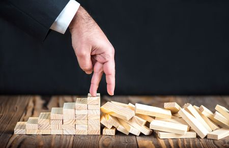 Businessman Coming To The End Of His Career, Unsuccessful Business Life Concept With Wooden Blocks On Rustic Desk Standard-Bild