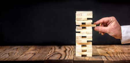Taking Risk To Make Buiness Growth Concept With Wooden Blocks Stock Photo - 69977917