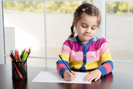 Little Girl Is Drawing Picture