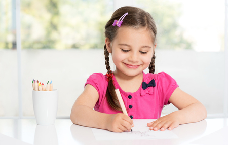 free education: Little Girl Is Drawing Picture