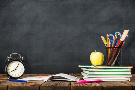 dirty room: Desk Of Student, Alarm Clock, Books and Pencils Stock Photo