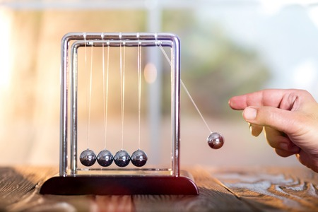 Concept For Action and Reaction or Cause And Result in Business With Newtons Cradle Stockfoto