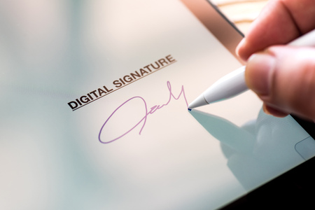 Digital Signature Concept with Tablet and Stylus Pen Stock Photo - 101122851