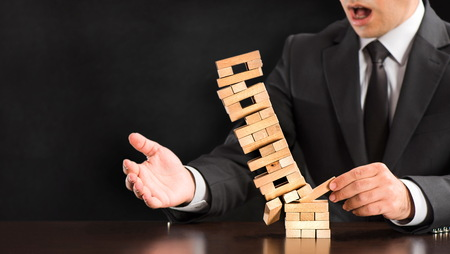 Businessman Fails Building Tower, Concept For Challenge And Fail In Business Stock Photo
