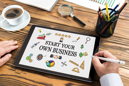 Start Your Own Business Concept on Digital Tablet Screen Banco de Imagens
