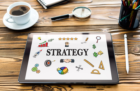Strategy Concept with Digital Tablet Screen on Work Desk Stock Photo